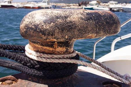 A mooring bollard with ropes