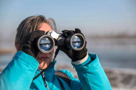 dutch girl: Woman looking through binoculars