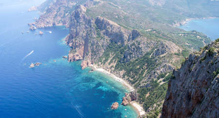 View from a ancient tower on the top of a very high mountain, overseeing the coast of Corsica Stock Photo