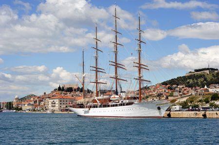 Large sailing boat with white sails docked at Sibenik port, Croatia. photo