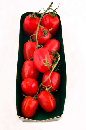Pack of small tomatoes isolated on the white Stock Photo - 12855237