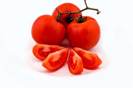 Organic tomato whole and cuted isolated Stock Photo - 12999965