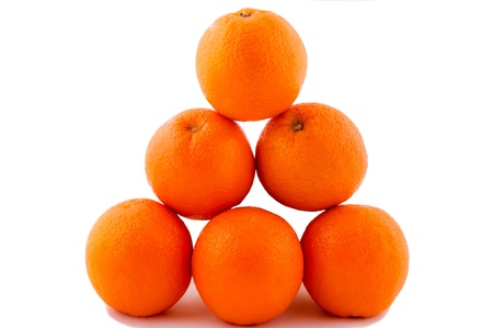 Oranges pyramide isolated on the white Stock Photo - 13233313