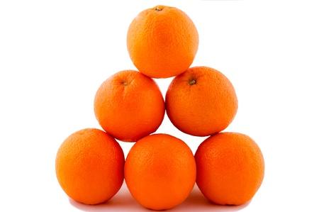 Oranges pyramide isolated on the white Stock Photo - 13233313