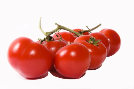 Tomatoes isolated on the white Stock Photo