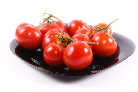 Tomatoe plate isolated on the white Stock Photo - 13504874