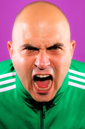 disinclination: Angry man isolated on purple
