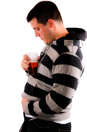 Man drink beer and touching his stomach photo