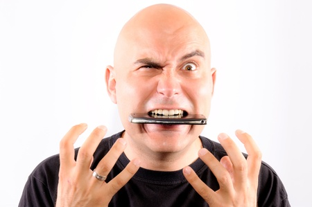 frustrated man: Bald guy eating mobile phone