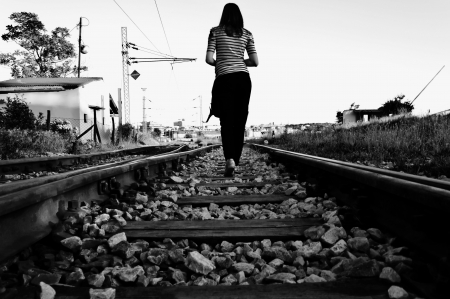 black and white railroad tracks: She is leaving
