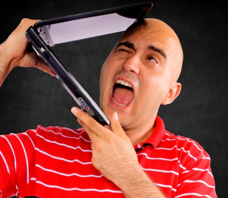 lap top: Lap top eating a bald guy