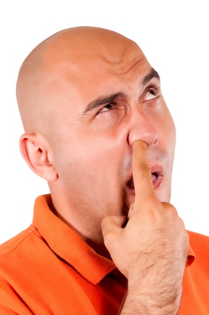 nose picking: Man picking the nose isolated