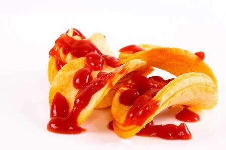 Potato chips and ketchup Stock Photo - 14348036