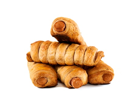 Sausage rolls isolated on white photo