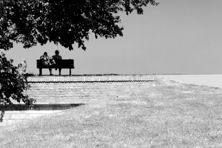 Two people siting on the bench photo