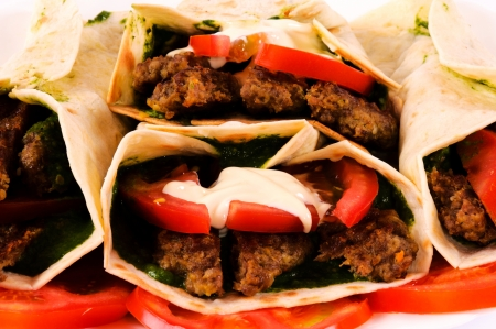 Bunch of gyros pita and vegetables photo