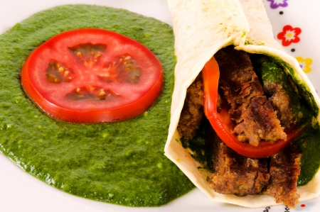 Spinach and kebab on the plate photo