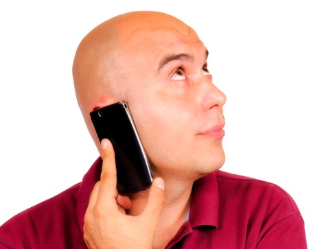 Bald guy talking on cell phone Stock Photo - 14381949