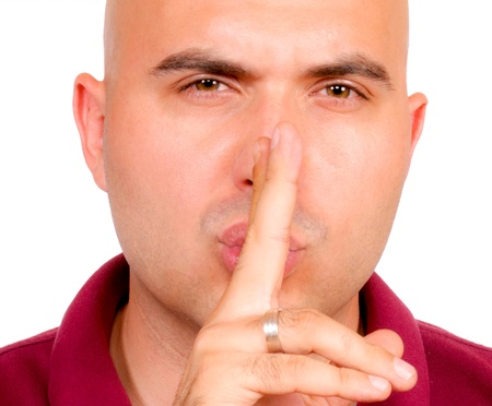 Man showing silence sign photo