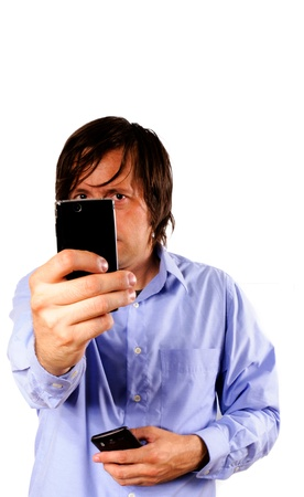 man taking picture with mobile phone Stock Photo - 14425935