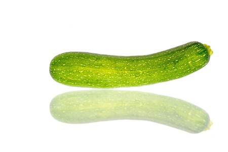 Green zucchini  isolated on white photo