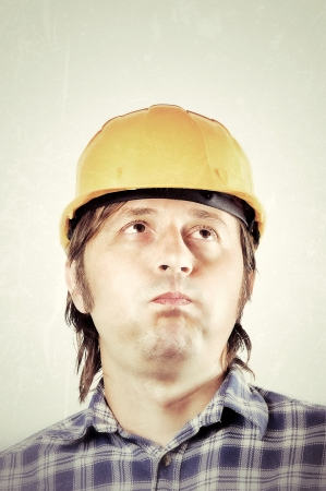Hard thinking by the worker Stock Photo - 14658052
