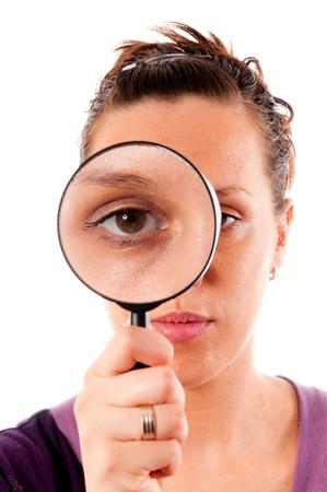 Female holding magnifer on her eye Stock Photo - 14658041