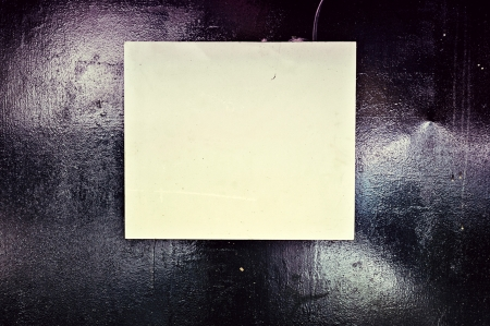 Blank paper on black metal Stock Photo - 14726690