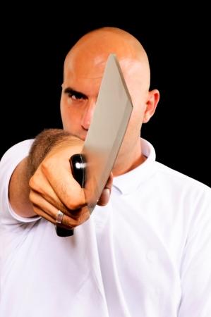 Bald man holding meat chopper Stock Photo - 14767623
