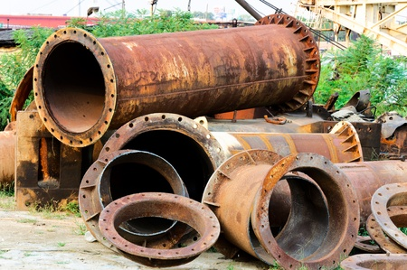 scrap heap: Old pipes on the junk yard