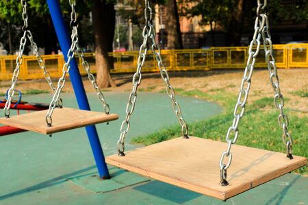 Wooden children swing photo