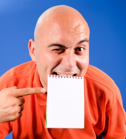 Bald guy holding blank paper in his mouth photo