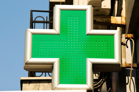 green cross: Sign of pharmacies on the street Stock Photo