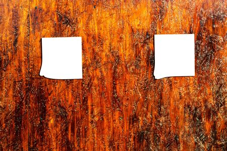 Two blank paper on the wooden background photo