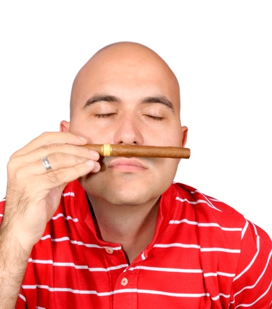 Bal man holding cuban cigar photo
