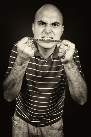 Angry man with the chain Stock Photo - 15433413