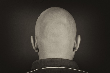 Man with bald head black and white photo