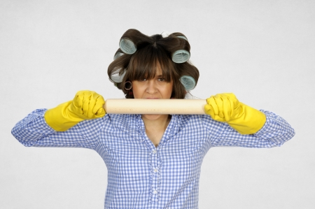 Funny housewife with rolling pin photo
