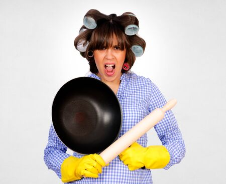houseclean: Dangerous housewife with rolling pin and frying pan