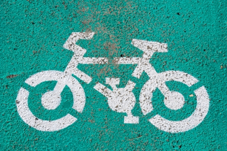 Small bicycle white and green sign photo