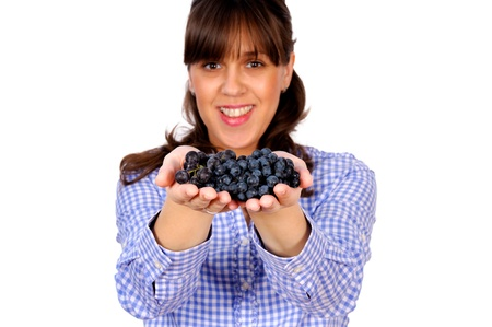 Fresh black grapes in the female hands Stock Photo - 15588124