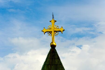 Golden cross on the roof photo