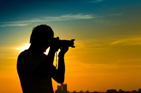 photographers: Landscape photographer in back light