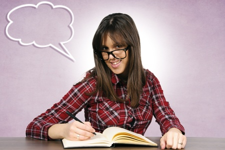 Young and attractive teacher writing on the table Stock Photo - 15762340