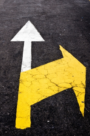 and in direction: Forward white and right yellow sign Stock Photo