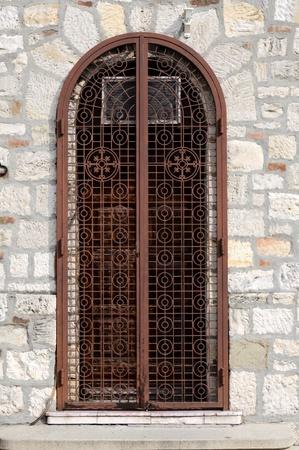 wood panelled: Old door in stone locked Stock Photo