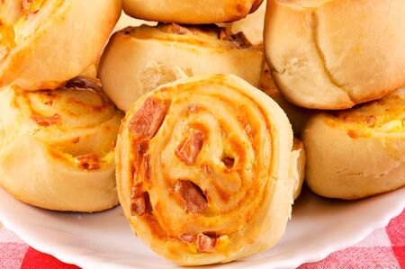 Ham and cheese pastry. Selective focus on the first pastry. Stock Photo - 15845383