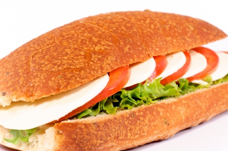 Mozzarella sandwich isolated on white. Selective focus on the middle of sandwich photo