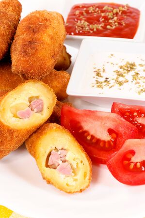 Tasty fried potato with ham. Selective focus on the front sliced stick Stock Photo - 15913312
