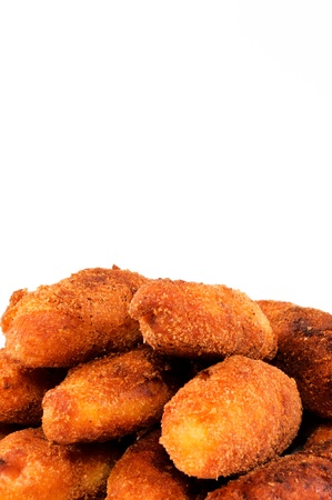 Fried food sticks isolated on white photo